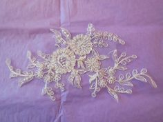 An ivory bridal beaded lace Applique / wedding bridal floral lace motif is for sale. colour: ivory  Size: 22.5x12.5cm Sold by 1 quantity= 1piece of lace applique  Fixed price GBP4 /piece  Please let me know if you have questions.