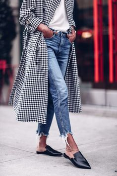 Gingham trench coat paired with worn denim