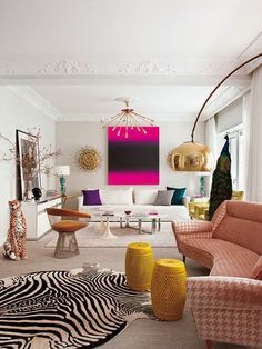 Living room designed by Alia's Living Pink studio. Love how the original moldings, kitchen tiles and other architectural details have been scrupulously preserved, creating a perfect background for the colourful mix of vintage and modern pieces.