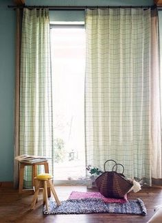 Linen woven checked curtains suggestive of canola flower.