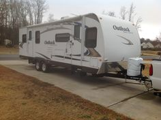 Our RV is a 2011 Keystone Outback at our home in Statham, Ga.