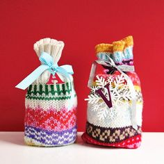 Hit the thrift stores for some colorful sweaters for a festive wrapping idea!  Use the sleeves for smaller gifts and wine and the rest of the sweater for larger gifts.  A little bit of sewing, some ribbon and a tag of some kind completes the look!