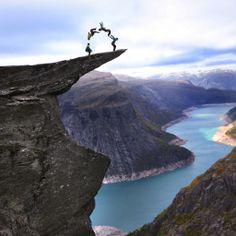 "Antics on ""the tongue of the troll"" in Norway. One of the most beautiful places in the country."