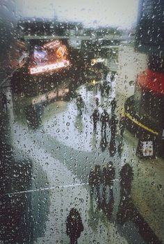 Rain by oscartales (me)  A little story about this photo: We were at the station and it was pouring and we had to run and we ended up a store and my mum was busy shopping and I was incredibly bored but I had my phone with me. I was staring out that window and the raindrops and the street pattern looked like art to me so I took this :)