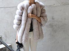 winter style. fur coat. white jeans