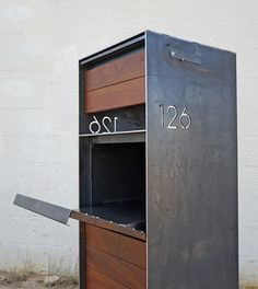 Steel manufacturing and fabrication in Austin, Texas. Detailed craftsmen who work with iron, metal & steel. Architectural finishes and construction. Mail Drop Box, Parcel Drop Box, House Gate Design, Door Gate Design, Drop Box Ideas, Package Mailbox, Farmhouse Mailboxes, Casa Magnolia, Modern Mailbox