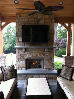 I like the stone, the wide hearth, and the TV above
