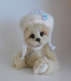 Ujka By zorkabears - Ujka is hand-sewn teddy bear. She measured 23 cm (9 in) standing. The body has five joints. She is filled with hollow fiber and natural granulate. The eyes are glass. She is made of faux fur.