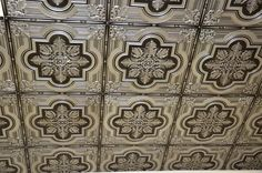 "PVC Faux Tin Ceiling Tile #206 Antique Silver: Size: 24""x24"" Installation type: Glue up and Drop In. Price: 10.99 USD Talissa's Décor Showroom, http://www.talissadecor.com/catalog/glue-up-faux-tin-ceiling-tiles/antique-finish-ceiling-tile"