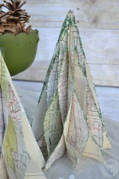 Christmas trees made from vintage maps, but you could also use books, sheet music, or  fun patterned paper.
