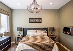 Amy & Todd's Mod Chicago Home House Tour | Apartment Therapy. Love that textured back wall, and the built in fireplace, and the lighting...so cool!