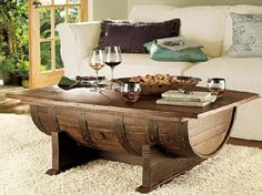 Wine Barrel Coffee Table. Lots of ideas and tutorials to make useful things with old barrels! Cool gifts for wine lovers.