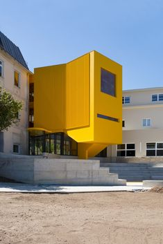 Aurora Arquitectos connects classroom blocks with bright yellow stair tower Yellow Stairs, Aurora, Landscape Plane, Magnolia Colors, Music School, Ground Floor Plan, Built Environment, Dezeen, Architect Design