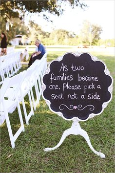 Pick a seat not a side scalloped chalkboard at ceremony. Captured By: Vine and Light Photography ---> http://www.weddingchicks.com/2014/05/14/soft-southern-vintage-wedding/