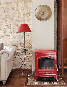 red fireplace in a neutral room
