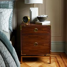NEW! Inspired by furniture designed for 18th century European explorers, our Malone Campaign Nightstand's brass hardware references the gilded corners on British empire-era travel chests.