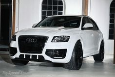 White Audi SUV Black on black rims