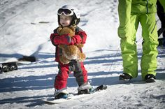 Baby Xander, age 2 yrs, snowboarding for the first time. Dont forget snowboarder Ted! Avoriaz