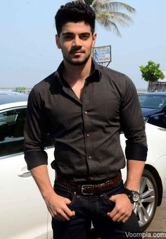 Sooraj Pancholi looks smart in a textured black shirt, jeans and a cropped hairstyle which is slightly different from what he sported in Hero. via Voompla.com