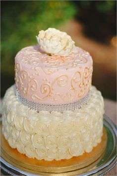 Gold piping, white rosettes, silver bling!
