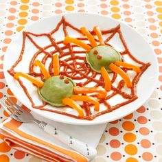 Ravioli and bell pepper spiders with tomato sauce web