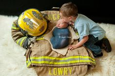 Firefighter newborn. Angela Schewe Photography