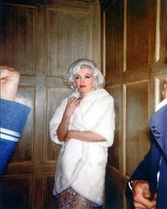 JFK BIRTHDAY GALA - Snapshot of Marilyn Monroe wearing white mink coat over body-hugging gown she wore to sing 'Happy Birthday' to President John F. Kennedy.