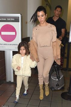 Hues the boss? The mother and daughter combo co-ordinated their looks, both opting for blu...