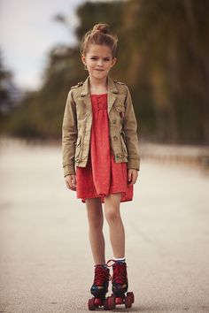 Loose bun and a cargo-coat over a sundress... shows the spunk that comes with this age!