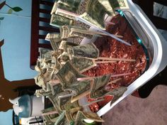 Money cake for teenager. Tape money on straws and stick into cake