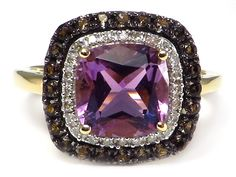 This lovely ring has an 8x8 mm (2.2 ct) cushion cut, genuine amethyst as the center stone surrounded by .48 ctw of round, genuine smokey quartz and .10 ctw of round, genuine, white diamonds. The setting is solid 14k yellow gold. #AmethystBrownQuartzRing #CushionAmethystRing