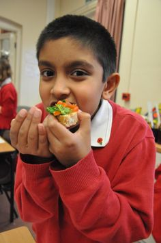 A pupil from Hythe Primary enjoying his tomato and basil bruschetta!