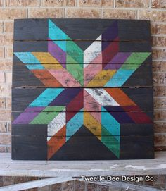 """Large multi-color Texas Star Barn Quilt made of reclaimed wood and hand painted. Size 33"""" x 33""""."""