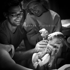 Birth Photography session.  Dad delivered his baby girl with the OB's help!     Sarah E Studios