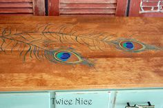dresser with painted peacock feathers: Twice Nice-- Love the blue + Peacock feathers. Very in this year, but I have always loved it! Primitive Painted Furniture, Hand Painted Furniture, Wood Furniture, Furniture Projects, Furniture Makeover, Furniture Refinishing, House Projects, Peacock Bedroom, Peacock Colors