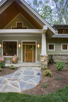 craftsman exterior, green shakes, white trim with wood windows, real stone wall and column wrap  ACM Design