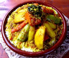 CousCous in Morocco. If you are going to eat it in a true Moroccan style, you will enjoy it with a      Moroccan bread. Usually round and flat with a soft inside and crusty outside-perfect for scooping couscous or tajine.  bun that has a crustier outside and tear pieces off to use this as a spoon!!