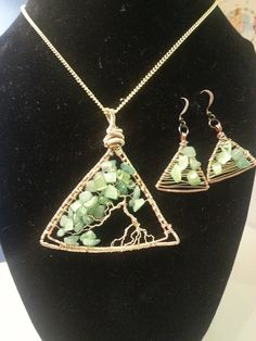 Wire wrapped copper and gold tree of lifr pendant necklace and earrings available in my Etsy shop https://www.etsy.com/listing/518622586/triangle-tree-of-life-pendant-and