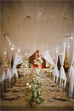 Wedding party table, with a white canopy + candles in glass globes suspended by crystals + white pomanders || Photos: J. Cogliandro Photography ~ Floral, Decor & Lighting: Flora & Eventi ~ Venue: Omni Houston Hotel