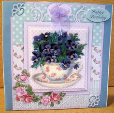 Shabby TeaCup Mini Kit on Craftsuprint designed by Diane Hannah - made by Jane Halton - I printed the design on to good quality smooth card and made it up with dst and foam pads. I then added some dark blue velum to the card and punched two corners of the design. I then layered it up and added a bow to the top. - Now available for download!