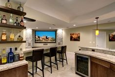 Contemporary Basement with Dry stacked stone veneer accent wall, Pendant light, Urestone stacked stone - slate grey