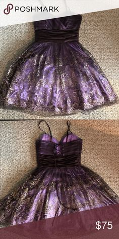 Semi formal dress This a beautiful semi formal dress that I wore once. It's a dark purple with a lighter purple liner. It has a brown satin band around the middle and a gold sparkly design throughout the bottom of the dress. A corset back with a zipper on the side and the dress has adjustable straps. Stain free and never altered. Dresses Prom
