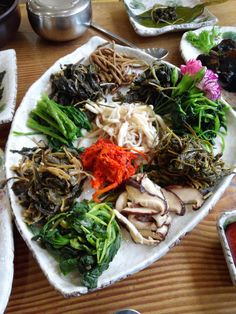 Korean side dishes  Gotta track down those mysterious roots and stems...  Some I know of: fern brakes, aster scaber, amaranthus, shepherd's purse.