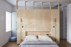 A Brooklyn brownstone features a DIY plywood headboard with a low recessed shelf, perfect for stashing current reads. See In Bed-Stuy, Brooklyn, a Renovated Brownstone with Inspired Solutions. Photograph by Jonathan Hokklo. Closet Bedroom, Home Bedroom, Bedroom Wall, Bedroom Furniture, Bedroom Decor, Closet Wall, Closet Curtains, Bedroom Shelves, Closet Space