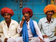 Friends share a stoop in Pushkar during the annual mela, or fair.