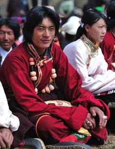 Handsome Tibetan guy  from near Dabpa, Kham (or Daocheng, Yunnan for the Chinese) dressed in traditional clothes a summer horse racefestival