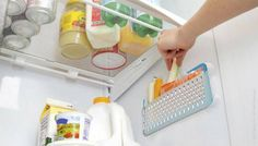 Hang suction baskets on the side of the fridge.