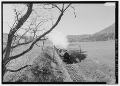 View of Locomotive No. 17 heading northbound about 1.4 miles north of Orbisonia, on the narrow-gauge main line. Locomotive No. 17, a 163, 500-pound steam locomotive, is the second largest of the EBT's six Baldwin Mikados, built in March 1918 by the Baldwin Locomotive Works in Philadelphia, Pennsylvania - East Broad Top Railroad & Coal Company, State Route 994, West of U.S. Route 522, Rockhill Furnace, Huntingdon County, PA. Published 1986.