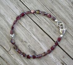 simple Garnet Gemstone Bracelet with Sterling Silver Accents and Clasp - Devotion by SplendorVendor. $44.00, via Etsy.