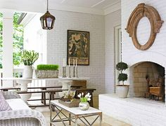 Covered Patio White Brick Fireplace - Design photos, ideas and inspiration. Amazing gallery of interior design and decorating ideas of Covered Patio White Brick Fireplace in living rooms, decks/patios, girl's rooms, porches by elite interior designers. Fireplace Surrounds, Fireplace Design, Porch Fireplace, Fireplace Ideas, Brick Fireplaces, Fireplace Mirror, Outdoor Fireplaces, Brick Porch, Simple Fireplace